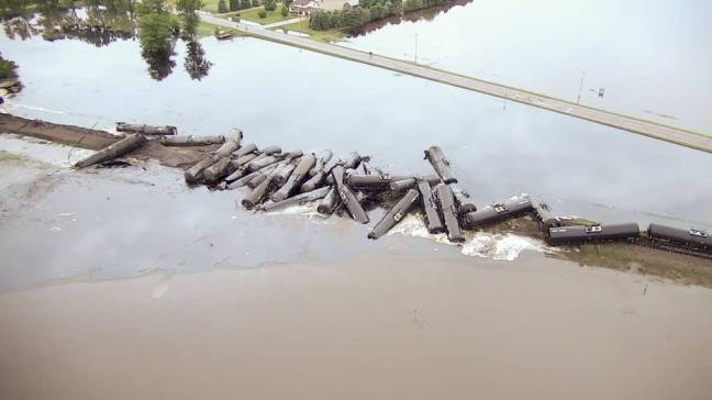 Derailed and leaking crude oil tank cars Doon Iowa